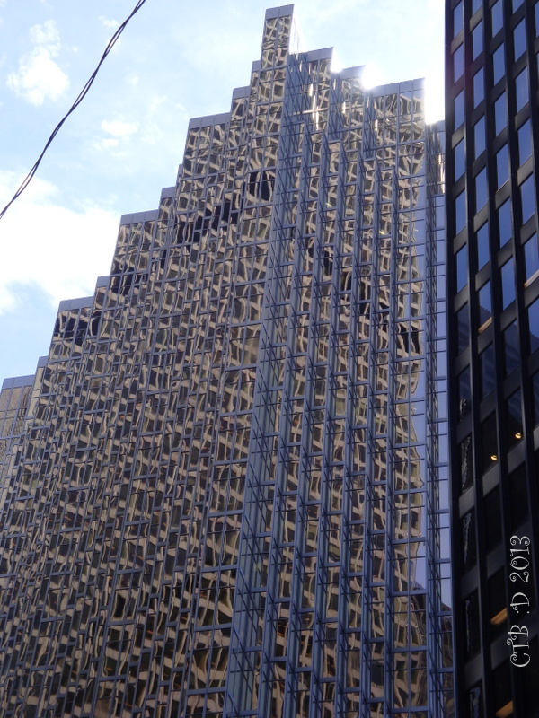 Interesting design of glass and shape reflects nearby buildings.