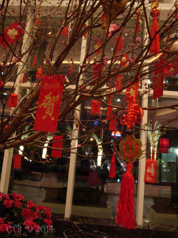 Red envolopes and lucky coins with tassels decorated this unique holiday tree.