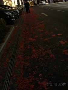 Red paper from firecrackers litter the streets.