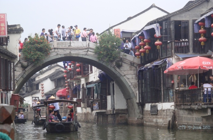 Crowds of People On Top of a Small Bridge