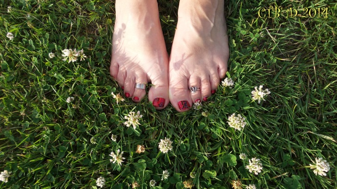 Soft grass to run bare foot in. My feet on Canadian soil.