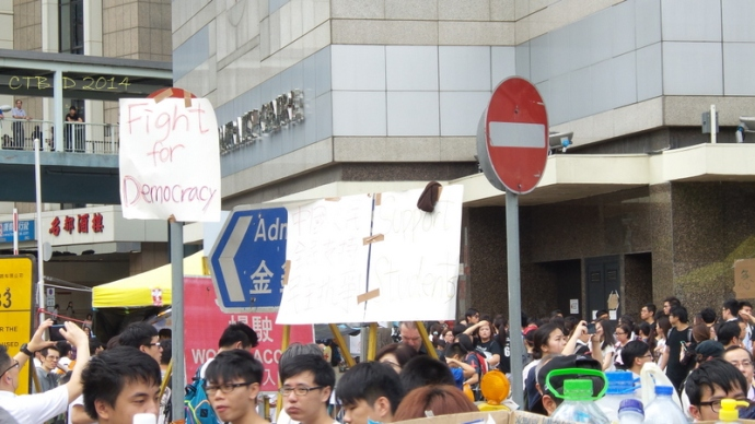 The contrast of signs on HK streets Sep. 29, 2014