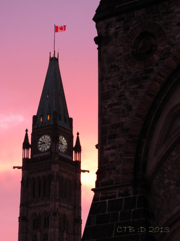 The Peace Tower and Canadian Flag a witness to lost innoncence in Ottawa on Parliment Hill